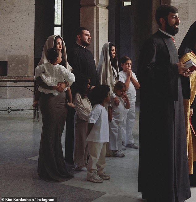 Photo showing Kourtney, and Kim and their kids as they wait patiently for bapism