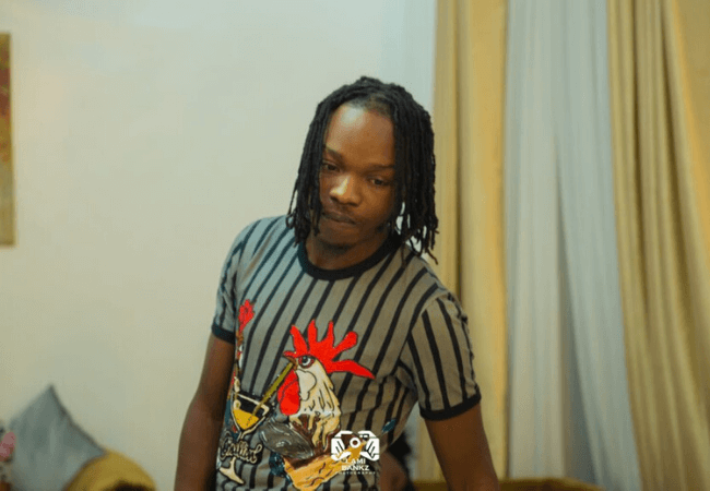Naira Marley shows off expensive cars following car theft allegations