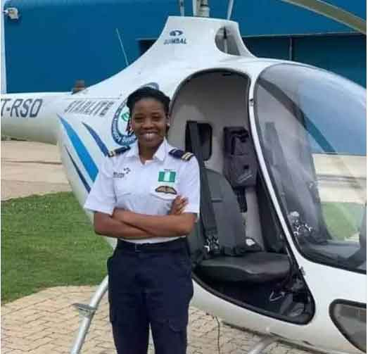 Tolulope Arotile posing with her  helicopter