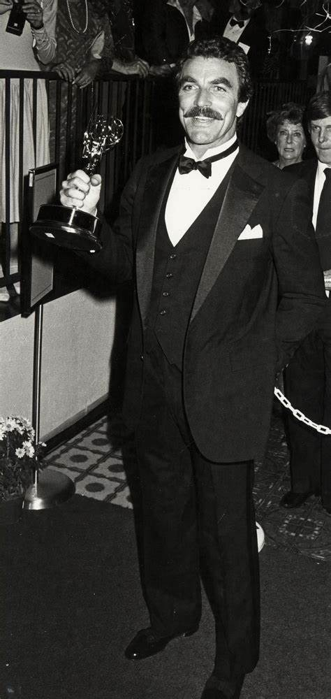 Tom Selleck shows off an award won